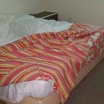 bed in bedroom. just a hard matress on a frame.