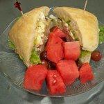 Sandwich with fresh fruit.