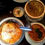 (Clockwise L-R) Chicken Pilau, yoghurt dip, Biryani Rice, Butter Chicken.