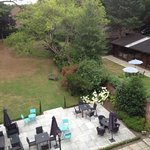 view from the back over swimming pool and garden