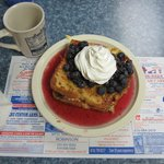 Stuffed French Toast with fresh blueberries & whipped cream.  Stuffed w/blueberries and cream ch