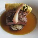 Ribeye steak in oxtail au jus.