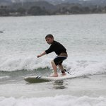 Our six year old surfing after his lesson!
