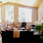 Living area/dining space - lots of sunlight and gorgeous views