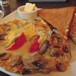 A two-egg omelette (it's normally 4) with tomatoes, mushrooms and cheese