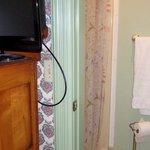 The dresser is adjacent to the door to the bathroom