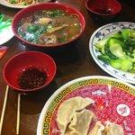 Roast duck soup, baby bok choy and pork dumplings