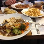 potatoes,chips and steak and ale pie is my serving the top plate is sweet and sour chicken and r
