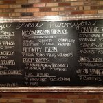 They list their local food providers on a blackboard inside the restaurant.