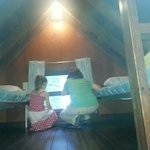 Two single beds on top loft. (Above bunk full-sized beds, not pictured) Bungalow #29