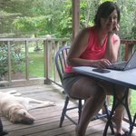 On the porch of the Speckled Trout with the friendly dog from across the stream