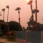 Smoke from a nearby fire colored the skies pink one late afternoon.