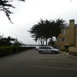 View of parking lot, bay is in background.