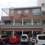 Front of the hotel and parking spaces