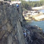 My wife rappeling down Otter Cliff as Avi belays from the edge.