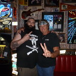 Guitarist Dowlin Mayfield and the bouncer at Hors and Heifers