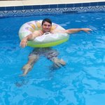 chilling in the pool... on a rubber ring!