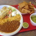 Chicken enchiladas with side of chips and guacamole