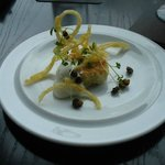 Amuse bouche: King salmon cake with goat cheese mousse, fried capers, and crispy potato