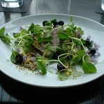 Salad course: Mache salad with pork headcheese, pickled blueberries, creme fraiche, and pistachi
