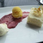 Dessert: Orange frosted blond cake with raspberry cream, lavender icecream, and passion fruit so