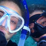 Ariel and Kari on their shore dive so thrilled to have found the frogfish!