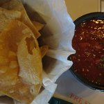 Excellent chips: flour and corn in two baskets, with salsa.