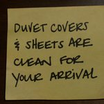 post it note on headboard, sheets and covers were clean