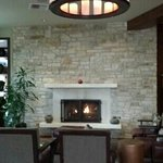 inviting fireplace next to the restaurant
