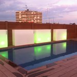 Roof terrace with pool in evening