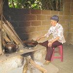 Old granny roasting coffee