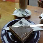A latte and a slice of chocolate & peppermint cake