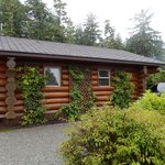 Side of cabin 17 and private parking space (holds 2 cars)