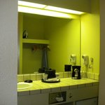 Dimly lit vanity w/ no towel bar