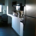 Full size fridge, two burner elect. stove, full size microwave, dishwasher