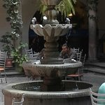 Three tier fountain in the center of the courtyard.