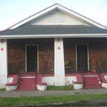 a house on the hurricane Katrina tour with rescuers cross on wall
