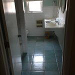 pretty clean tile and bathroom with double sinks
