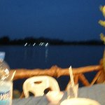 An evening view from the restaurant to the next island.