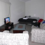 cabin: bathroom, dining and kitchen area, lounge, wifi, large bed and extra area with single bed