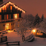 The chalet is beautiful at night lit up in the snow!