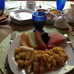 Breakfast, including many fresh fruits which were delicious and not just garnish.