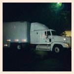 Semi with 53ft trailer in parking lot after website says no truck parking,  Rockford, Illinois