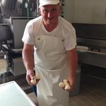 The owner of the cheese factory showing us fresh Mozzarella