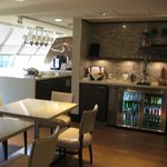 Club lounge -beverage fridge with view of coffee station in back left.