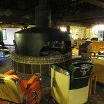 Lobby area - barbershop chairs and locomotive engine fireplace