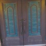 Old church doors act as front door for hotel