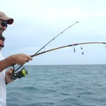Scott Woodhams of Central America Overland Expeditions deep sea fishing off Hatchet Caye