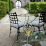 A glass of cremant in the courtyard