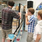Boys blowing glass